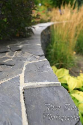 Stone retaining wall in garden